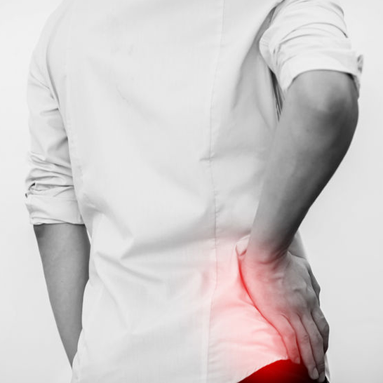Hip Pain -Man Touching Hip - Dr Andrew Dutton