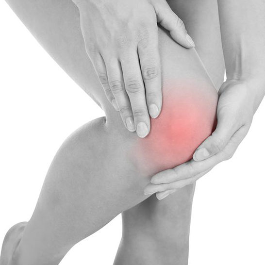 Knee Pain - Woman Holding Knee - Dr Andrew Dutton