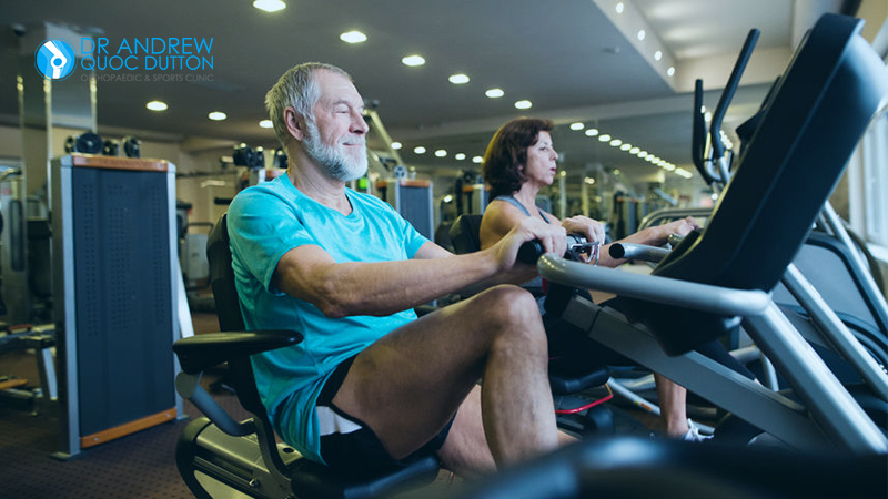 Handsome Middle Age Man Aerobic Exercise For Knee